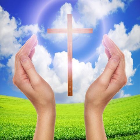 hands praying with cross in sky-easter concept